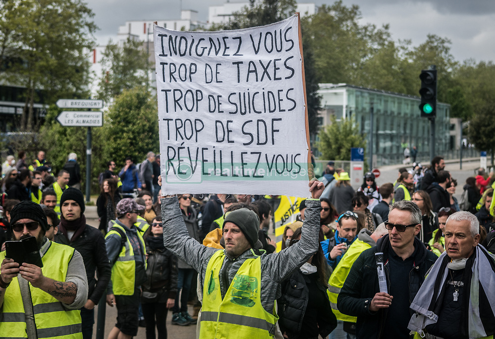 April 27, 2019 - Nantes, France - Yellow vests demonstrators take part in the ''Act 24'' protest in Nantes, France, on April 27, 2019. Macron's reforms, the culmination of three months of national debate, have not convinced the leaders of the Gilets Jaunes, which they feel are hollow words and proof that Macron has not listened to what has been said in the street during the last five months of protests. (Credit Image: © Estelle Ruiz/NurPhoto via ZUMA Press)