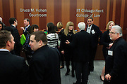 The Chicago-Kent College of Law hosts an opening reception and demonstration of the new Bruce M. Kohen Courtroom on Thursday, January 24th, 2013. The technologically advanced venue sports dual 90 inch screens along with multiple technology connection points for courtroom presentations. Kohen, a 1979 Kent graduate is seen chatting with attendees directly below his name on the wall. © 2013 Brian J. Morowczynski ViaPhotos
