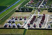 Nederland, Zeeland, Zierikzee, 12-06-2009; nieuwbouwwijkje in aanbouw, eengezinswoningen met puntdak. De huizen met klassiek pannendak worden geisoleerd, de blauwe woningisolatie is nog zichtbaar bij de huizen links..Swart collectie, luchtfoto (25 procent toeslag); Swart Collection, aerial photo (additional fee required).foto Siebe Swart / photo Siebe Swart