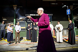 June 14, 2017 - London, London, UK - London, UK. A bishop blesses Borough Market with holy water and prays as shop owners and traders get ready for the reopening of Borough Market in London on 14 June 2017, following a terror attack that killed 8 people over a week ago. (Credit Image: © Tolga Akmen/London News Pictures via ZUMA Wire)