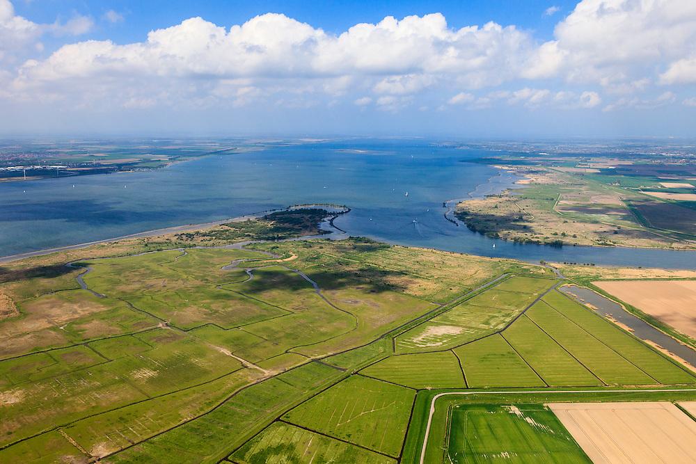 Nederland, Zuid-Holland, Hoeksche Waard, 09-05-2013; Spui richting Haringvliet met Goeree-Overvlakkee links aan de horizon. Onder Hoeksche Waard, met Korendijkse Slikken, rechts boven het midden Voorne-Putten.<br /> Islands and mudflats between South Holland and Zealand.<br /> luchtfoto (toeslag op standard tarieven)<br /> aerial photo (additional fee required)<br /> copyright foto/photo Siebe Swart