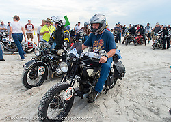 Dennis Leggett riding his 1936 Indian Sport Scout passes through the start on the sands of Daytona Beach at the beginning of stage 1 of the Motorcycle Cannonball Cross-Country Endurance Run, which on this day ran from Daytona Beach to Lake City, FL., USA. Friday, September 5, 2014.  Photography ©2014 Michael Lichter.