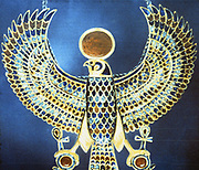 Treasure of Tutankhamun (dc1340 BC): Pectoral jewel of gold, semi-precious stone and faience showing Horus, falcon-headed god crowned with sun disc with ankh, symbol of life, attached to each claw. Once great sky and sun-god, became combined with Horus the son of Isis and Osiris.  Cairo Museum, Egypt