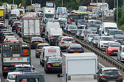 © Licensed to London News Pictures 28/05/2021. Charlton, UK. The May bank holiday getaway has started on the A102 Blackwall Tunnel Southern Approach in London with traffic at a near standstill. Millions of cars are expected on the roads this weekend as people make the most of the sunny weather with a weekend away to visit family and friends. Photo credit:Grant Falvey/LNP