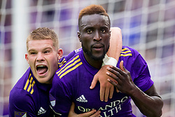 May 6, 2018 - Orlando, FL, U.S. - ORLANDO, FL - MAY 06: Orlando City forward Chris Mueller (17) celebrates with Orlando City defender Lamine Sane (22) after he scored a goal during the soccer match between the Orlando City Lions and Real Salt Lake on May 6, 2018 at Orlando City Stadium in Orlando FL. Photo by Joe Petro/Icon Sportswire) (Credit Image: © Joe Petro/Icon SMI via ZUMA Press)