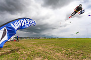 Kites soar over the crowds. Windscape Kite Festival, Swift Current, Saskatchewan.