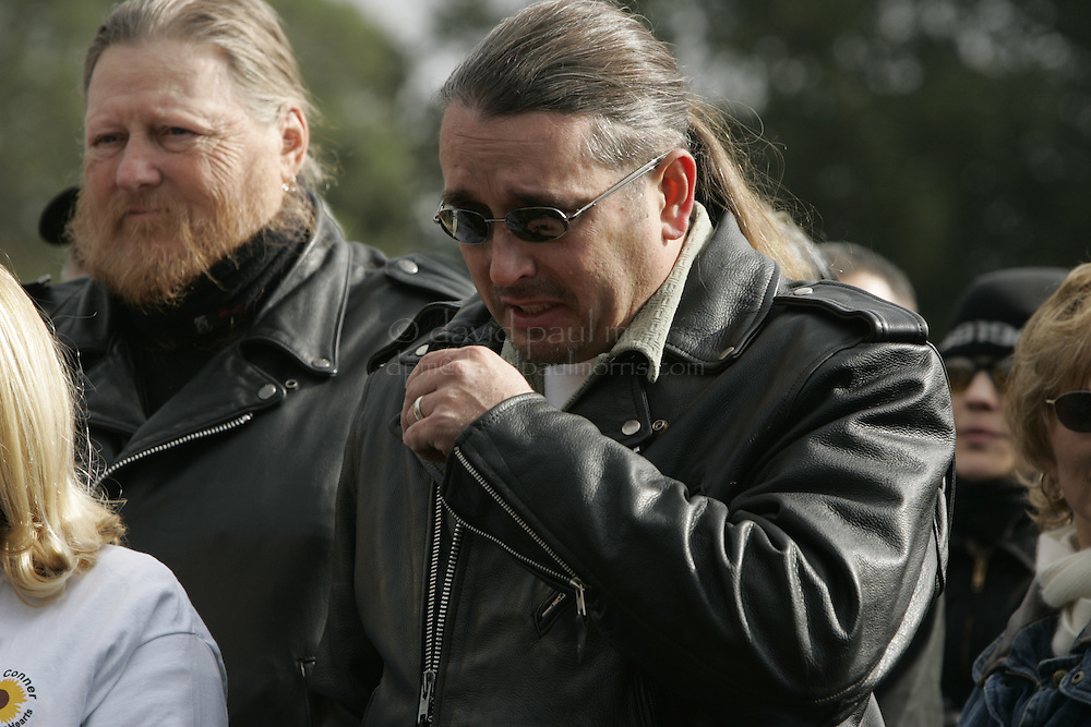 Modesto, CA - NOVEMBER 20: Shawn Rocha Laci Peterson's cousin tries to hold back the tears as he speaks during a brief stop at the Burwood Cemetery in Escalon where Laci Peterson is buried. To his left is Mickey Jones. Over 2,000 people take part in the second annual Laci Peterson Memorial Motorcycle ride in Modesto, California on Saturday November 20, 2004. Laci was murdered along with her unborn son, Conner in December 2002 by her husband Scott Peterson who was found guilty of  first degree of murder by a San Mateo, California jury on November 12, 2004 and could face the death penalty. Photograph by David Paul Morris