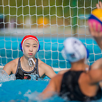 Rita Dravucz (R) of Hungary prepares to hit the goal protected by Yang Jun (L) of China during the women waterpolo friendly match of Hungary and China in Tatabanya, Hungary on June 23, 2012. ATTILA VOLGYI