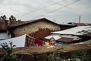 Una donna stende il bucato nel cortile della sua abitazione, Addis Ababa 25 settembre 2014.  Christian Mantuano / OneShot <br /> <br /> A woman hangs out the washing in the backyard of her home, Addis Ababa September 25, 2014.