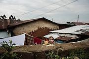 Una donna stende il bucato nel cortile della sua abitazione, Addis Ababa 25 settembre 2014.  Christian Mantuano / OneShot <br /> <br /> A woman hangs out the washing in the backyard of her home, Addis Ababa September 25, 2014.