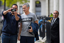 © Licensed to London News Pictures. 27/05/2016. London, UK.  JOSE MOURINHO poses for a selfie with Portuguese Man U fan, STEVEN RIBEIRO (left), as he returns to  his home in west London on the day he was officially announced as the new manager of Manchester United Football Club. Photo credit: Ben Cawthra/LNP
