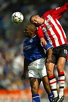Photo Aidan Ellis.<br />Leicester City v Southampton (FA Barclaycard Premiership) 16/08/2003.<br />Leicester's Les Ferdinand and Southampton's Danny Higginbotham.