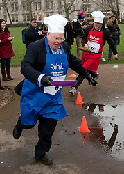 "© Licensed to London News Pictures. 12/02/2013. London, UK. British Liberal Democrat Lord Rennard (blue apron) takes part in the annual Rehab Parliamentary Pancake Race in Westminster, London.  Deputy Prime Minister Nick Clegg today said he was made aware of ""indirect"" concerns about the Lib Dems' former chief executive LORD RENNARD in 2008. Photo credit: Matt Cetti-Roberts/LNP"