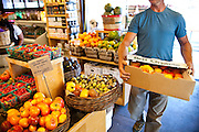 Dave Bell of Bell Organic Gardens delivers organic heirloom tomatoes to a boutique neighborhood market in Salt Lake City.
