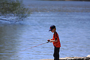 It's May 10, 2014, and spring is finally here. After a long and brutal winter in the Great Lakes region, youngsters are so happy to be able to get outdoors. This young man is hoping to tie into a big walleye on the Fox River in De Pere, Wisconsin.