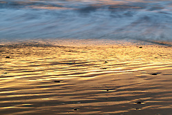 Beach and Pacific Ocean at sunset, Hug Point State Recreation Area, Oregon, USA