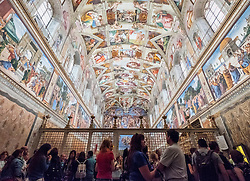 tourists looking at ceiling in Sistine Chapel in the Vatican Museum in Rome, Italy