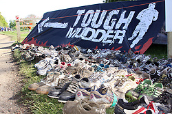 ©Licensed to London News Pictures. 13/05/2012.Boughton House, Northants. Tough Mudder's boots of those who went before at the end of 12 mile endurance challenge. All the left shoes are cleaned and sent to Africa.Photo credit: Steven Prouse/ LNP