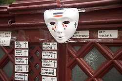 May 9, 2017 - London, United Kingdom - A mask, flowers and the stickers with the names are pictured outside the Venezuelan Embassy in London on May 9, 2017. The Venezuelan community of London protested against the President of Venezuela, Nicolas Maduro. (Credit Image: © Alberto Pezzali/NurPhoto via ZUMA Press)