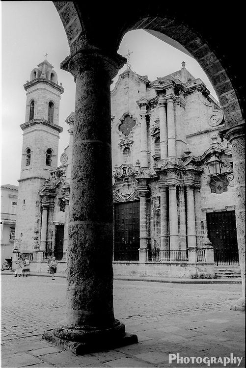 Black and white of spanish colonial architecture of  a cathedral and plaza in Havana