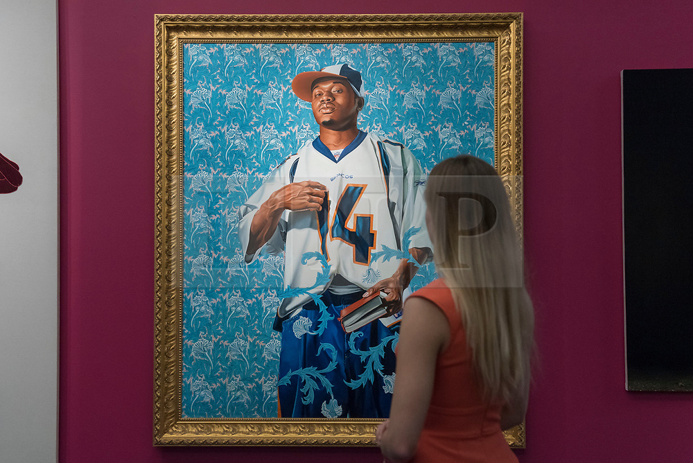"""© Licensed to London News Pictures. 08/09/2017. London, UK. A staff member views """"St. Francis"""", 2007, by Kehinde Wiley (Est. GBP30-40k), at a preview of 'Shake It Up', a collection of contemporary artworks from the personal collection of celebrity photographer Mario Testino. Proceeds from the upcoming auction of the collection at Sotheby's in London will benefit Museo Mate in Lima, Peru.  Photo credit : Stephen Chung/LNP"""