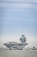 The Royal Navy's newest and largest ever warship, HMS Queen Elizabeth leaves Portsmouth this evening for sea trials in the North Atlantic. The aircraft carrier will visit New York and will embark F35 fighter jets for the first time. The carrier is due to enter operational service in 2021.<br /> Picture date Saturday 18th August, 2018.<br /> Picture by Christopher Ison. Contact +447544 044177 chris@christopherison.com