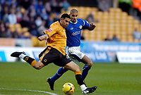 Photo: Leigh Quinnell.<br /> Wolverhampton Wanderers v Leicester City. Coca Cola Championship. 09/12/2006. Wolves' Lewis Gobern gets the ball away from Leicesters Patrick Kisnorbo.