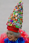 Gertrude Shilling (Mrs Shilling) wearing an unusual hat, made from small gift boxes, at Royal Ascot.