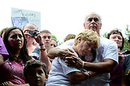 Cindy Anthony is comforted by George Anthony, second from right, during a memorial ceremony at the site where the body of their granddaughter Caylee Anthony was found on what would have been her sixth birthday in Orlando, Fla., Tuesday, Aug. 9, 2011.  Their daughter Casey Anthony was acquitted of the most serious charges related to Caylee Anthony's death.(AP Photo/Phelan M. Ebenhack)