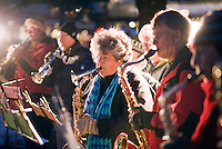 Betty Terrill, 80, performs Christmas carols with the Jackson Hole Community Band on Friday evening before the Town Square Lighting ceremony.