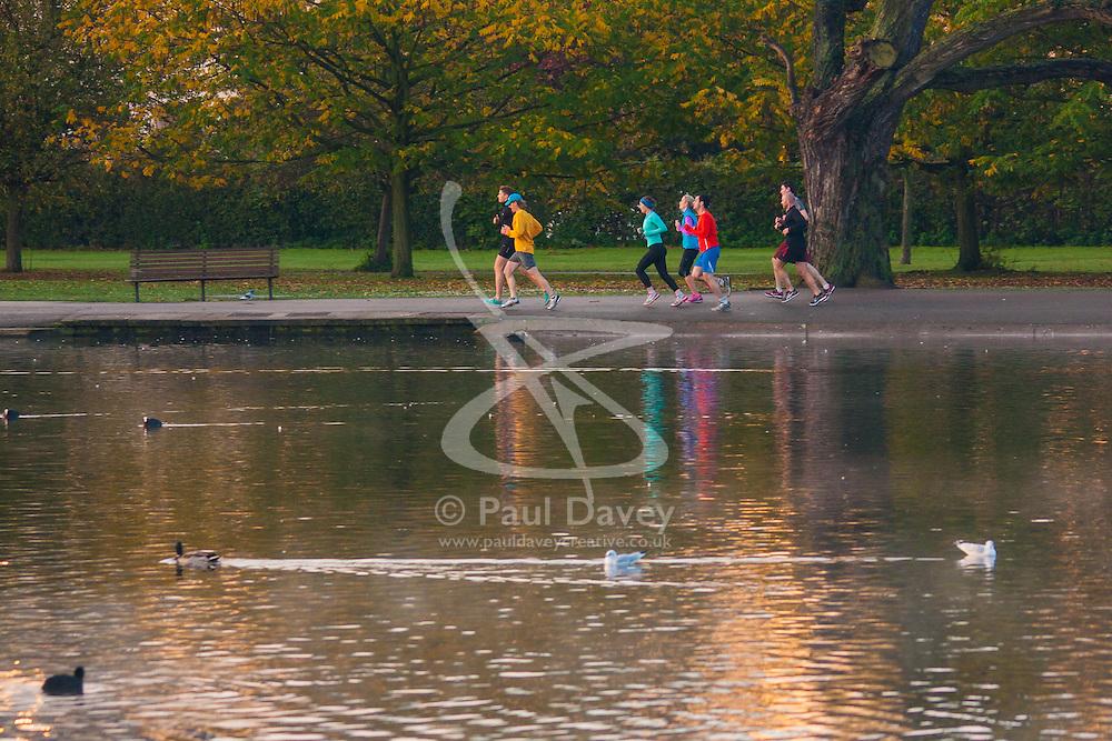 Regent's Park, London, November 4th 2014. A group of runners enjoy the early morning sunshine in Regents Park.