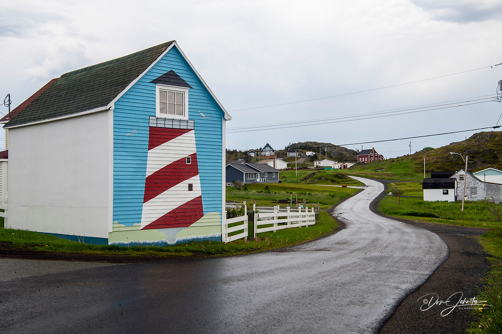 Lighthouse painted on the end wall of a shed, Twillingate, Newfoundland and Labrador NL, Canada