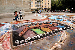 """North America, Mexico, Oaxaca Province, Oaxaca, sand tapestries (Tapetes de Areña) in Zocalo plaza.   These  """"carpets""""  are made from sand, dyed sawdust, seeds, flower petals and powdered lime during annual Day of the Dead (Dias de los Muertos) celebration in November"""