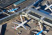 Nederland, Noord-Holland, Haarlemmermeer, 11-12-2013; luchthaven Schiphol. Stationsgebouw en aan de gates geparkeerde vliegtuigen van onder andere KLM.<br /> Schiphol Airport with terminal building and at the gates of parked aircraft, amongst others KLM.<br /> luchtfoto (toeslag op standard tarieven);<br /> aerial photo (additional fee required);<br /> copyright foto/photo Siebe Swart