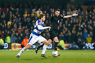 Referee Michael Oliver signals play on as Queens Park Rangers midfielder Luke Freeman (7) runs with the ball during The FA Cup 5th round match between Queens Park Rangers and Watford at the Loftus Road Stadium, London, England on 15 February 2019.