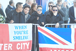 Aiyawatt Srivaddhanaprabha and mother Aimon (centre) with family members at Leicester City Football Club, Leicester Chairman Vichai Srivaddhanaprabha, was among those to have tragically lost their lives on Saturday evening when a helicopter carrying him and four other people crashed outside King Power Stadium.