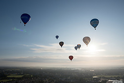 © Licensed to London News Pictures. 29/07/2019; Bristol, UK. Press preview flight for the 41st Bristol International Balloon Fiesta 2019 which will take place from 08 - 11 August 2019. For the preview up to 25 hot air balloons will take off from Filton Airfield, next to the Brabazon Hangar which is the site of a proposed new YTL Arena, and Aerospace Bristol to play homage to the 50th anniversary of Concorde. The Bristol International Balloon Fiesta attracts hundreds of thousands of visitors and this year the Fiesta will be celebrating Icons of Bristol and look to highlight some of the things that make up the home of the International Balloon Fiesta. The event has joined forces with Aerospace Bristol to honour one of the city's most famed creations, Concorde and Aardman Animations who are celebrating the 30th anniversary of Wallace and Gromit. Over the course of four days, the Bristol International Balloon Fiesta will play host to more than 100 colourful hot air balloons of all sizes and shapes. Special shapes are an iconic part of the Fiesta and the event kicks off with its now traditional special shapes launch on Thursday evening of 08 August. Photo credit: Simon Chapman/LNP.
