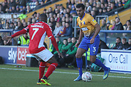 Malvind Benning of Mansfield Town (3) tries to beat Mark Marshall of Charlton Athletic (7) during the The FA Cup match between Mansfield Town and Charlton Athletic at the One Call Stadium, Mansfield, England on 11 November 2018.