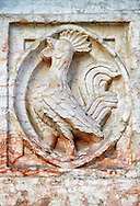 Medieval relief sculptures of mythical bird on the exterior of the Romanesque Baptistery of Parma, circa 1196, (Battistero di Parma), Italy .<br /> <br /> If you prefer you can also buy from our ALAMY PHOTO LIBRARY  Collection visit : https://www.alamy.com/portfolio/paul-williams-funkystock/romanesque-art-antiquities.html<br /> Type -     Parma    - into the LOWER SEARCH WITHIN GALLERY box. <br /> <br /> Visit our ROMANESQUE ART PHOTO COLLECTION for more   photos  to download or buy as prints https://funkystock.photoshelter.com/gallery-collection/Medieval-Romanesque-Art-Antiquities-Historic-Sites-Pictures-Images-of/C0000uYGQT94tY_Y