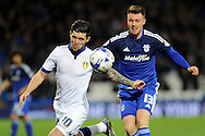 Leeds United's Alex Mowatt (l) challenges Cardiff City's Anthony Pilkington. Skybet football league championship match, Cardiff city v Leeds Utd at the Cardiff city stadium in Cardiff, South Wales on Tuesday 8th March 2016.<br /> pic by Carl Robertson, Andrew Orchard sports photography.