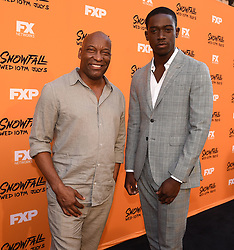 LOS ANGELES - JUNE 26: Executive Producer John Singleton and Damson Idris attends FX Networks and FX Productions Premiere event for 'Snowfall' at The Theatre at the Ace Hotel on June 26, 2017 in Los Angeles, California. (Photo by Frank Micelotta//FX/PictureGroup) *** Please Use Credit from Credit Field ***