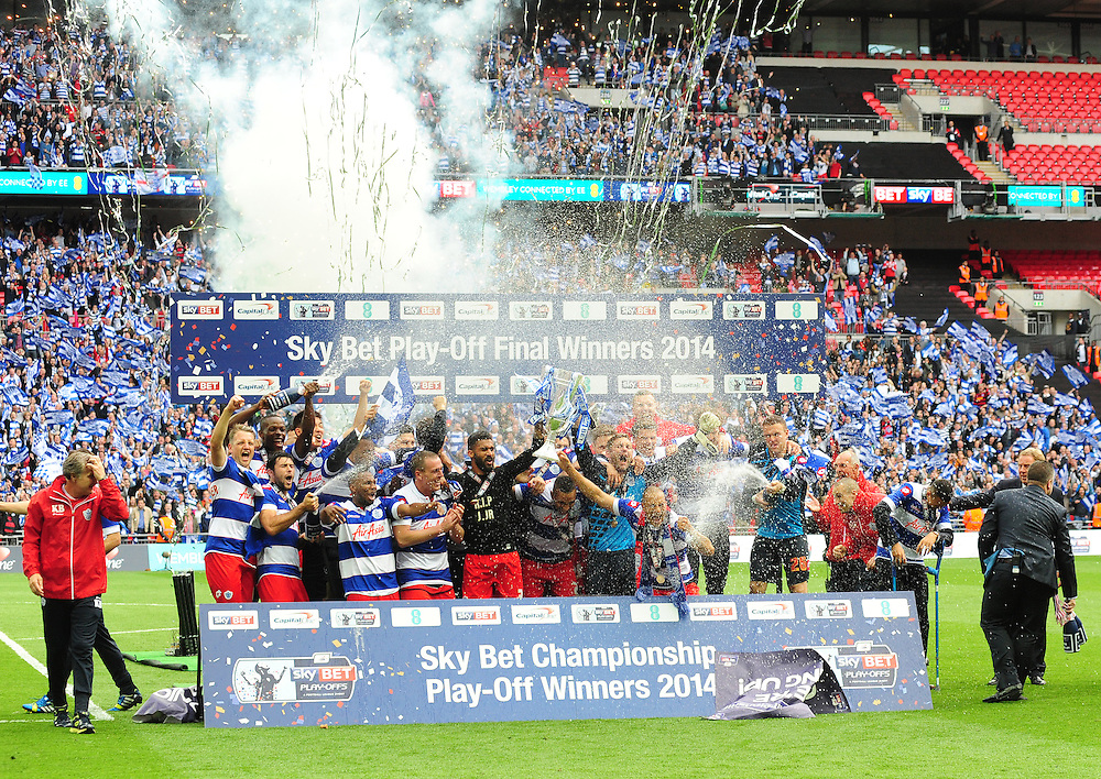 Queens Park Rangers players and coaching staff celebrate their promotion to the Premier League<br /> <br /> Photographer Chris Vaughan/CameraSport<br /> <br /> Football - The Football League Sky Bet Championship Play-Off Final - Derby County v Queens Park Rangers - Saturday 24th May 2014 - Wembley Stadium - London<br /> <br /> © CameraSport - 43 Linden Ave. Countesthorpe. Leicester. England. LE8 5PG - Tel: +44 (0) 116 277 4147 - admin@camerasport.com - www.camerasport.com