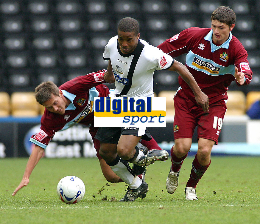 Photo: Dave Linney.<br />Derby County v Burnley. Coca Cola Championship. 11/03/2006.Derby's Kevin Lisbie(C)  escapes the attention of   Jon Harley(L)   John Spicer(R)