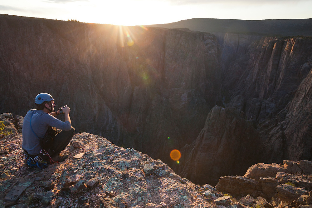 Obadiah Reid enjoys the views from Island Peaks at sunset in Black Canyon of the Gunnison National Park, Colorado.