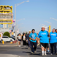 052714       Cable Hoover<br /> <br /> Alton Yazzie carries a the Special Olympics torch ahead of a procession of athletes, law enforcement officers and others Tuesday in Gallup.