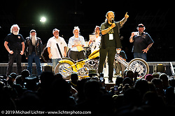Chris Callen helps pick the winner of the Charlie Brechtel chopper on the Buffalo Chip Main Stage during the Sturgis Motorcycle Rally. SD, USA. Friday, August 13, 2021. Photography ©2021 Michael Lichter.