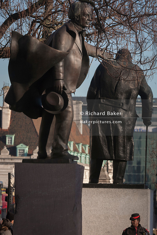 The statues of David Lloyd-George and Winston Churchill on 18th January 2017, in Parliament Square, London England. On the left is David Lloyd George 1st Earl Lloyd-George of Dwyfor, OM, PC a British Liberal politician and statesman. And on the right is Winston Churchill was a British wartime Prime Minister.