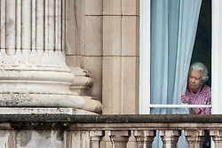 Embargoed to 0001 Wednesday December 28 File photo dated 12/06/16 of Queen Elizabeth II looking out of the window of Buckingham Palace, London, before attending the Patron's Lunch in honour of the Queen's 90th birthday.