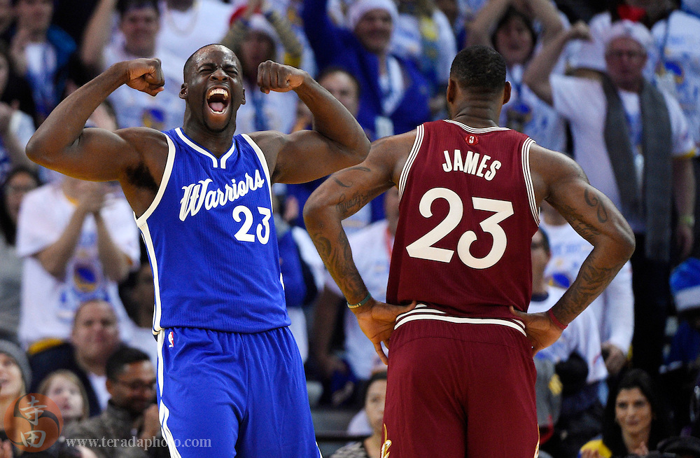 Dec 25, 2015; Oakland, CA, USA; Golden State Warriors forward Draymond Green (left) reacts as Cleveland Cavaliers forward LeBron James (right) looks on in the first half of a NBA basketball game on Christmas at Oracle Arena.