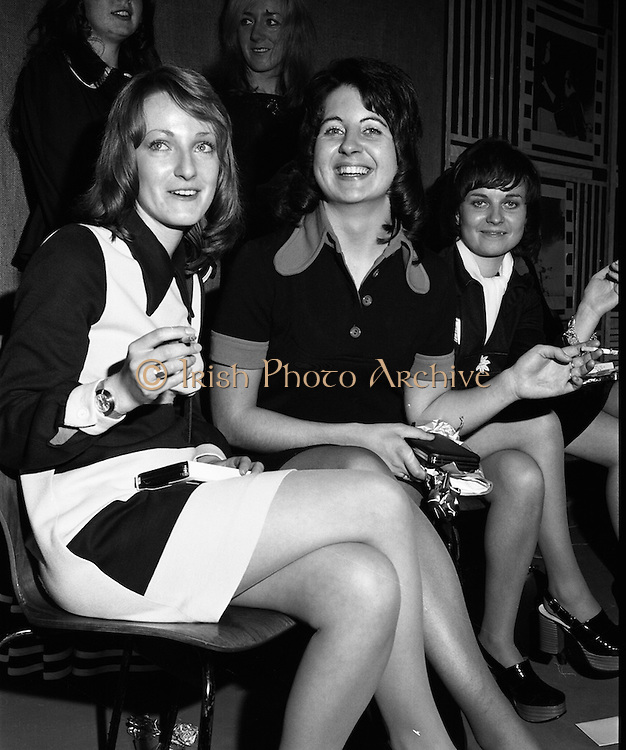 Classified Telephone Girl of the Year..1972..18.12.1972..12.18.1972..18th December 1972..The Area Final Ireland of the Classified telephone Girl of the year 72/73 was held in the Telecommunications Centre, Booterstown Ave. The winner will go forward to the next round at The Grand Hotel,Manchester in February next..The competition was organised by The Irish Times..The contestants were:.Ms Kathy Bannon, Farming Life, Belfast..Ms Carol Budd, Evening Herald,Dublin..Ms Dorothy Gough,Irish Field,Dublin..Ms Linda Hanna,News Letter,Belfast..Ms Susan Harrigan,Sunday News,Belfast..Ms Sophie Kelleher,The Cork Examiner..Ms Marie O'Callaghan,Evening Echo,Cork..Ms Bernadette O'Neill,Irish Independent,Dublin..Ms Rose O'Riordan,Irish Times,Dublin..Ms Pat O'Connell,Belfast Telegraph...Picture of Ms Marie O'Callaghan (Evening Echo) and Ms Sophie Kelleher(Cork Examiner) waiting to compete in the competition. Supervisor Ms Valerie Jackson is also included in the picture.
